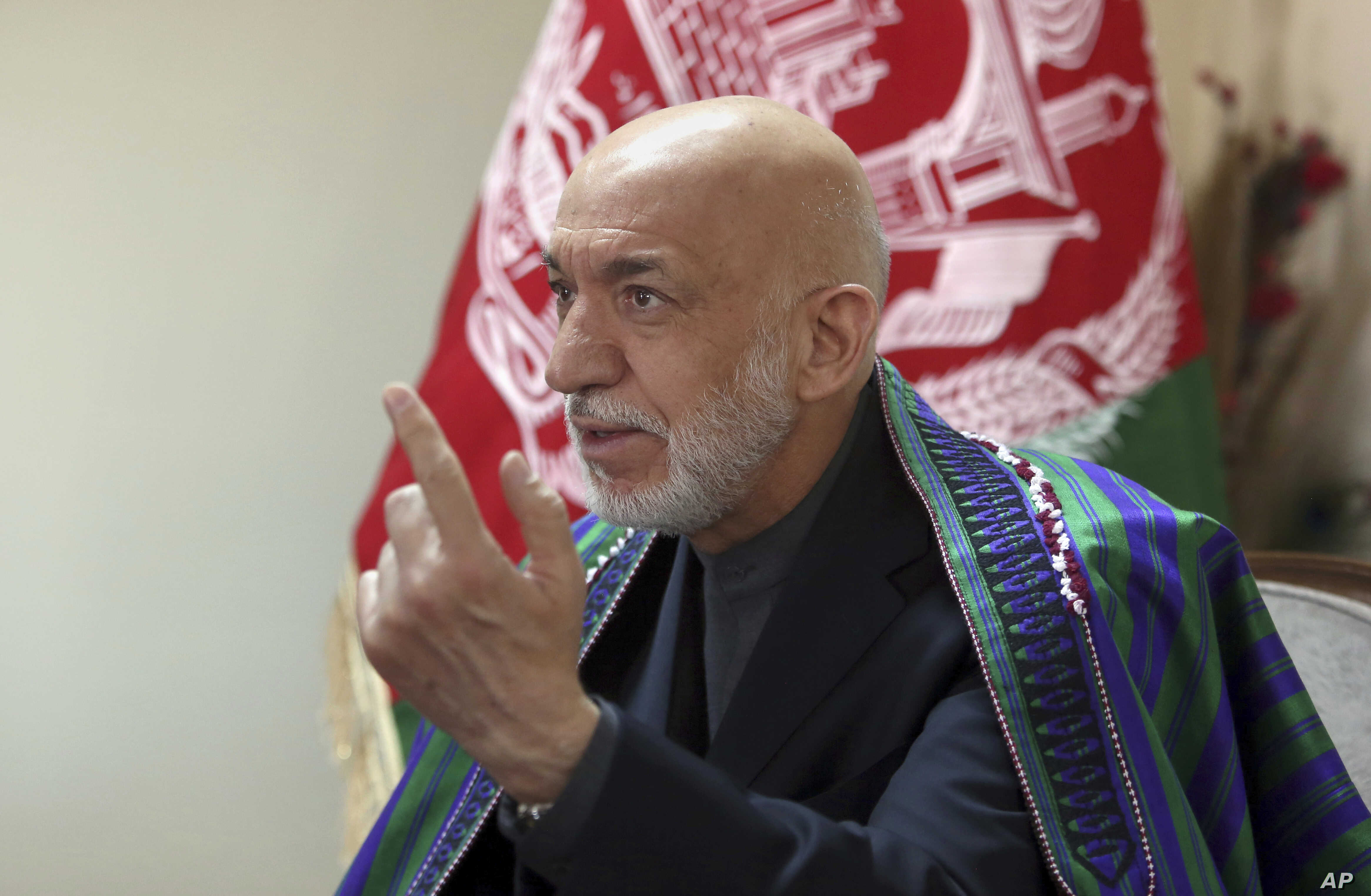 """Former Afghan President Hamid Karzai speaks during an interview with the Associated Press in Kabul, Afghanistan, Monday, April 17, 2017.  Karzai said that the U.S. is using Afghanistan as a weapons testing ground, calling the recent use of the largest-ever non-nuclear bomb """"an immense atrocity against the Afghan people."""" Last week, U.S. forces dropped the GBU-43 Massive Ordnance Air Blast (MOAB) bomb in Nangarhar province, reportedly killing 95 militants. (AP Photo/Rahmat Gul)"""